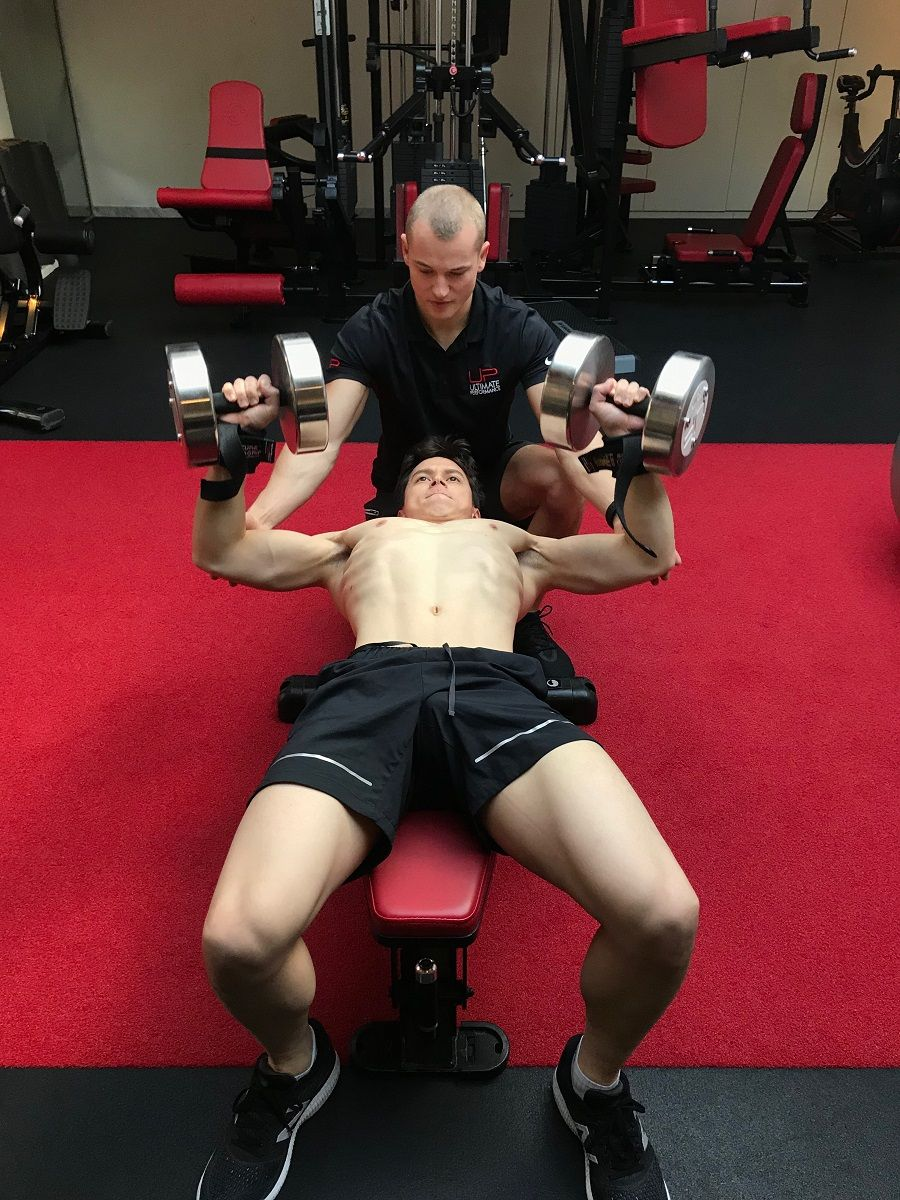 Christopher-in-the-gym-dumbbells-900-web